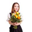 attraktive junge Frau im Dirndl mit Blumenstrauss