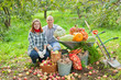 couple with  harvested vegetables