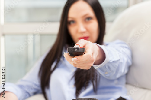 Attractive Woman with remote in her hands