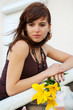 Detaily fotografie Sad young woman with a flowers