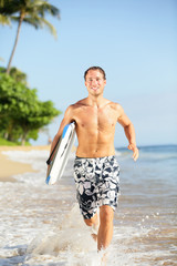 Beach lifestyle people - man surfer with surfboard