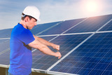 technician maintaining  solar panels poster