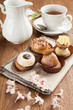 Pastries with chocolate and cream with tea