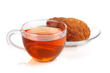 Glass cup of black tea with homemade cookies