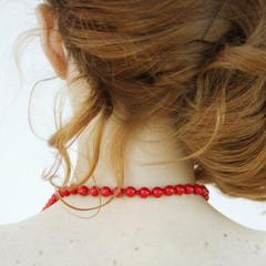 El collar de perlas rojo