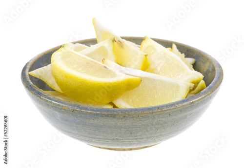 Lemon wedges in old bowl