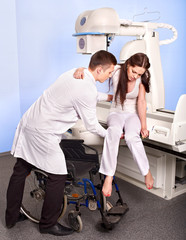 Patient and doctor in x-ray room.