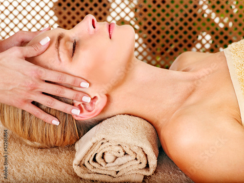 Woman getting  facial massage .
