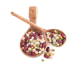 A mixture of beans in a wooden spoon on a white background