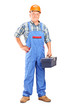 Full length portrait of a confident manual worker holding a tool