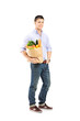 Full length portrait of a guy holding a shopping bag
