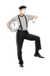 Full length portrait of a mime artist holding a clock and checki