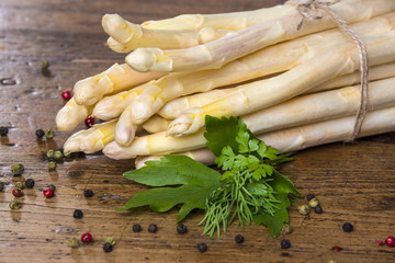 still life with a white asparagus on wooden table