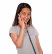 Asiatic charming young woman speaking on phone