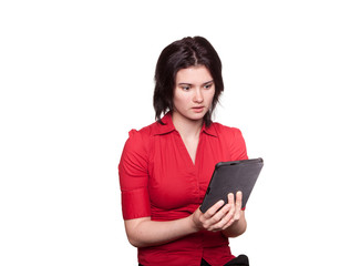Woman reading a tablet in suspense