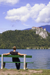Woman on Bench, enjoys summer day in Bled Lake, Slovenia