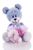 blue teddy bear stuffed animal with pink blossom.