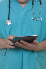 Doctor working on a digital tablet
