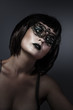 Doll, beautiful brunette with short hair and Venetian mask, caba