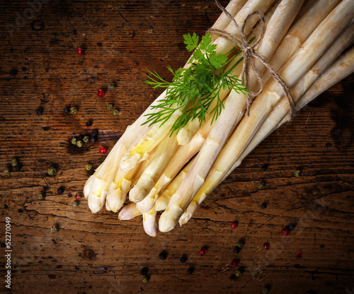 a white asparagus on a wooden board