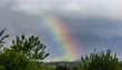 Storm clouds and rainbow at Jura mountain range, Switzerland
