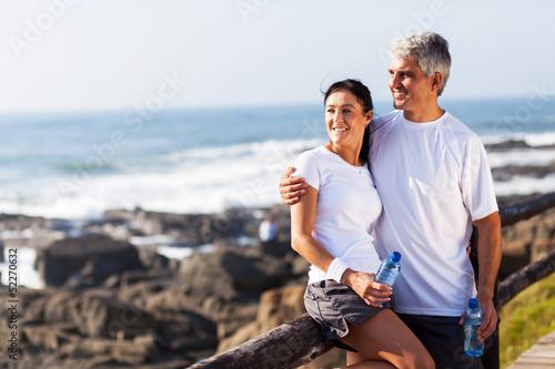 Leinwanddruck Bild mature couple relaxing after exercise