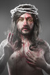 Jesus Christ with a halo of white light over grey background
