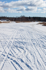 Ski run on frosty river in the winter time