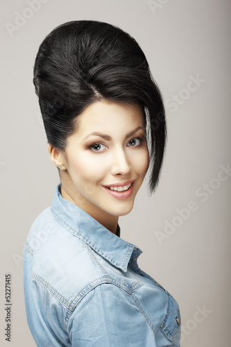 Happiness. Charisma. Brunette in Blue Jeans Jacket. Refinement