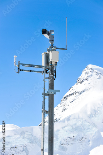 Weather Measurement Instrument with snow mountain in background