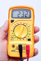 holding digital multimeter