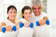 portrait of fit family having fun with dumbbells