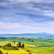Tuscany, farmland and cypress trees. San Quirico Orcia, Italy.