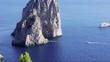 Yachts anchored in Le Faraglioni in Capri island; Italy.