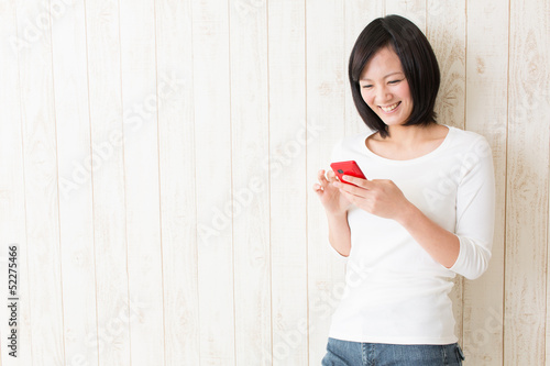 beautiful asian woman using smart phone