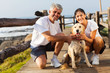 Quadro sporty middle aged couple and pet dog