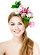 Smiling beautiful woman with flowers in her hair