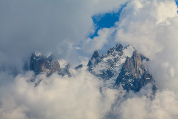 Rocky peaks and storm clouds over French Alps, in summer