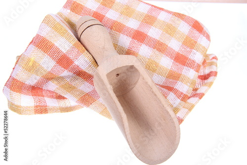 Kitchen towel and spoon  isolated on white background