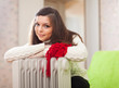 woman  warms near warm heater