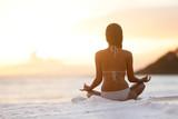Fototapety Meditation - Yoga woman meditating at beach sunset