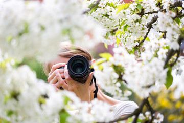 Pretty female photographer outdoors on a lovely spring day