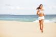Running woman jogging on beach