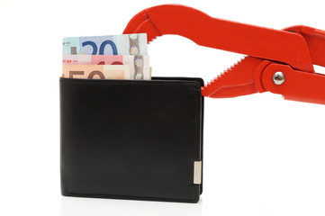 money problems with wallet and pipe Wrench