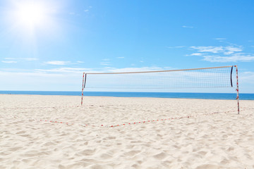 The summer sea beach volleyball court. Under the sun.