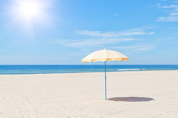 The only beach umbrella on the sea in summer under the sun.