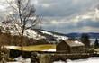 Stone built barn in winter