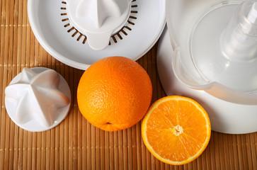 Fruit juicer and oranges