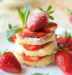 stack of homemade curd pancake with strawberry slices