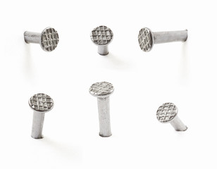 Metal nails collection on white, clipping path included